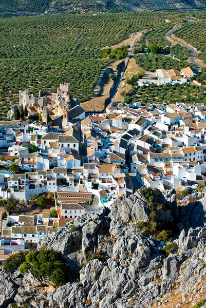 Rocky mountains, white village of Zuheros, a moorish castle and fields of olive trees.