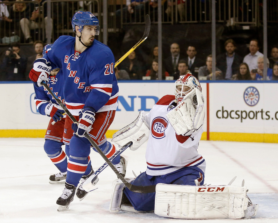 . New York Rangers left wing Chris Kreider (20) watches as Montreal Canadiens goalie Dustin Tokarski gloves the puck during the second period of Game 3 of the NHL hockey Stanley Cup playoffs Eastern Conference finals, Thursday, May 22, 2014, in New York. (AP Photo/Kathy Willens)