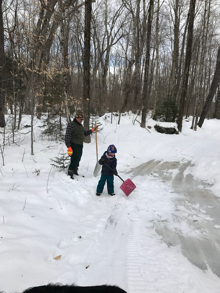 Poppa and G shoveling snow onto the Woodcock after an ice jam and flood.