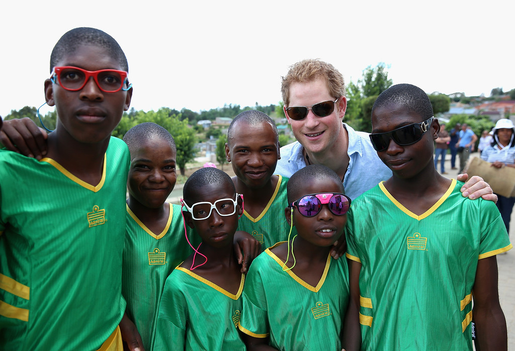 . Prince Harry poses with children during a visit to the Thuso Centre for children living with multiple disabilities on December 7, 2014 in Bute-Bute, Lesotho. (Photo by Chris Jackson/Getty Images for Sentebale)
