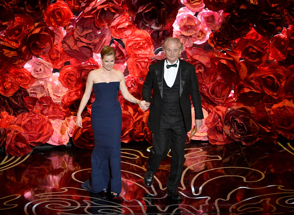 . Actors Amy Adams (L) and Bill Murray speak onstage during the Oscars at the Dolby Theatre on March 2, 2014 in Hollywood, California.  (Photo by Kevin Winter/Getty Images)