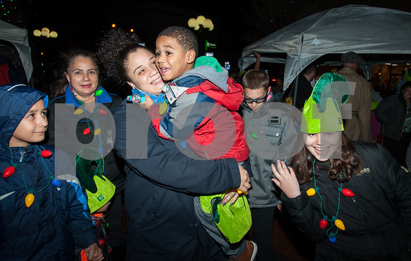 12/05/17 Wesley Bunnell | Staff New Britain held their annual Tree Lighting at Central Park on Tuesday evening with a visit from Santa Claus. Carter Moore, age 4, smiles as he looks at Santa while being held by mom Sinead Colom.
