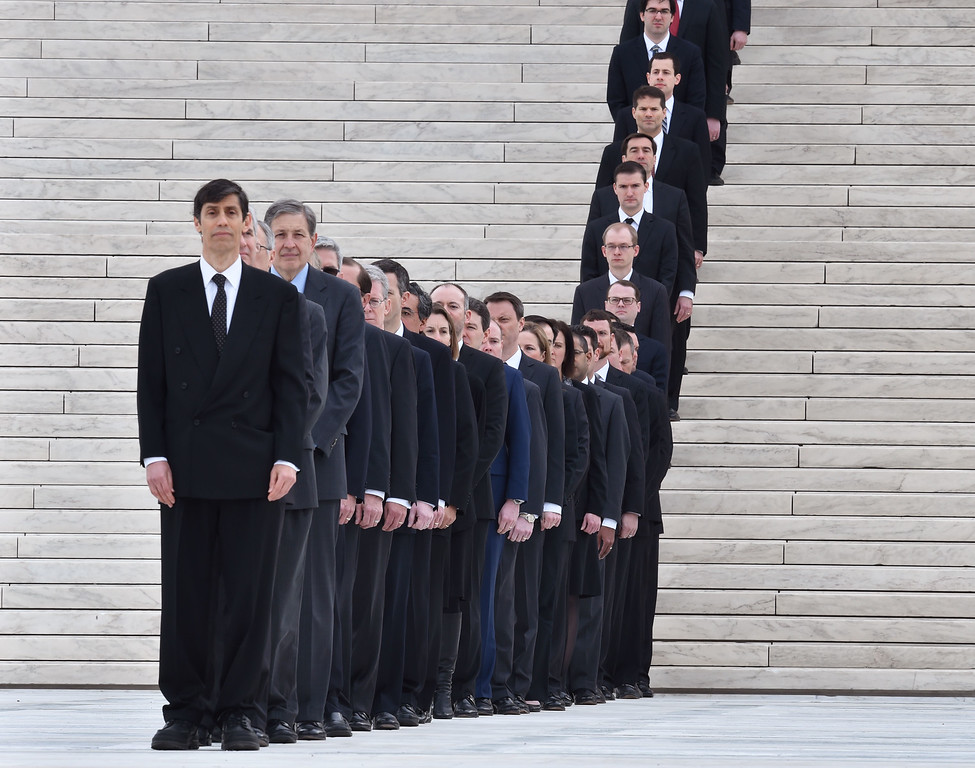 . A row of Law clerks await to pay their respects during the arrival of US Justice Antonin Scalia\'s casket on the  steps of the US Supreme Court February 19, 2016 in Washington, DC. / AFP / PAUL J. RICHARDS/AFP/Getty Images