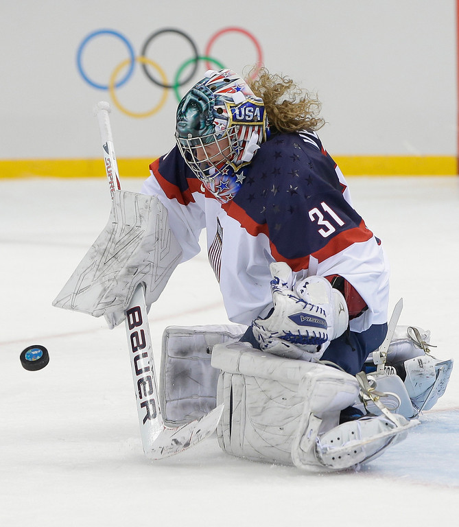 . USA Goalkeeper Jessie Vetter blocks a shot on the goal during the second period of the 2014 Winter Olympics women\'s ice hockey game against Canada at Shayba Arena, Wednesday, Feb. 12, 2014, in Sochi, Russia. (AP Photo/Matt Slocum)