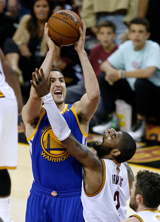 . Golden State Warriors guard Klay Thompson, left, shoots on Cleveland Cavaliers guard Kyrie Irving (2) during the second half of Game 3 of basketball\'s NBA Finals in Cleveland, Wednesday, June 7, 2017. (AP Photo/Ron Schwane)