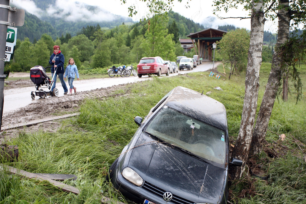 . This picture taken on June 4, 2013 shows a car in the ravin following flooding in Kossen. All long-distance rail services west of Vienna -- including to Germany and Switzerland -- were suspended late Sunday due to flooding along the line, as hundreds around the country were evacuated from their homes and the search for two missing people continued.  PIERRE TEYSSOT/AFP/Getty Images