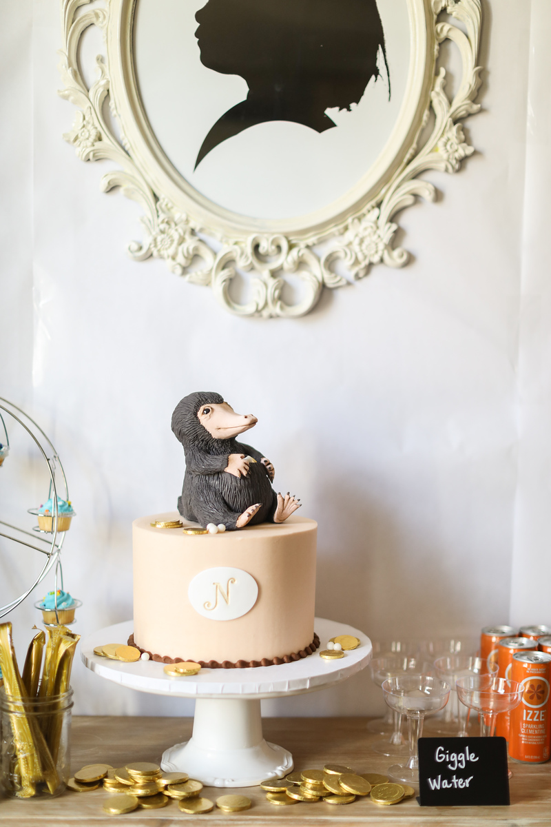 Fantastic Beasts birthday party cake with niffler on top. The cake is by Angel Cakes LLC in Frederick.