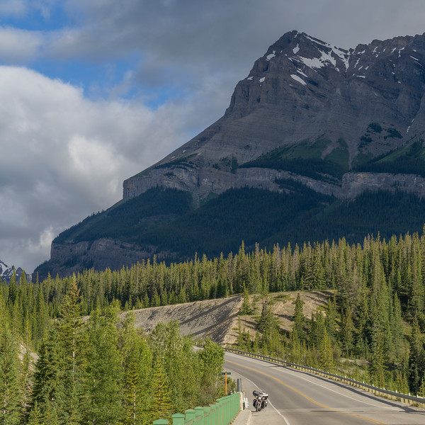 Highway with mountains in the background, Saskatchewan River Crossing, Icefields Parkway, Jasper, Alberta, Canada