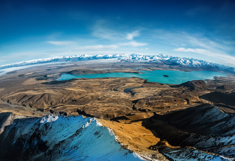 """<h2>Over Lake Tekapo</h2> <br/>Here's one of my favorite images from that day in the chopper. Shooting from a helicopter is always tough. If you watched that video, you'll see I switched a lot between different cameras. Even though I am using the Sony NEX-7 a lot, I chose the Nikon here because of the extreme conditions. I was quite worried I would only get a few minutes to shoot, so I wanted to make sure I did not run into any buffering problems… this is why I went with the Nikon.<br/><br/>Don't know what buffering is? That is what happens when you take a whole bunch of photos in a row and the camera has to save them quickly. On lesser cameras, sometimes you can only take a few photos before there is a long pause while it writes the photos. The NEX-7 lets met get in about 10-13 photos before it starts going slow. The Nikon D3s lets me take about 30+ I think!<br/><br/>- Trey Ratcliff<br/><br/><a href=""""http://www.stuckincustoms.com/2013/06/24/more-about-project-loon/"""" rel=""""nofollow"""">Click here to read the rest of this post at the Stuck in Customs blog.</a>"""