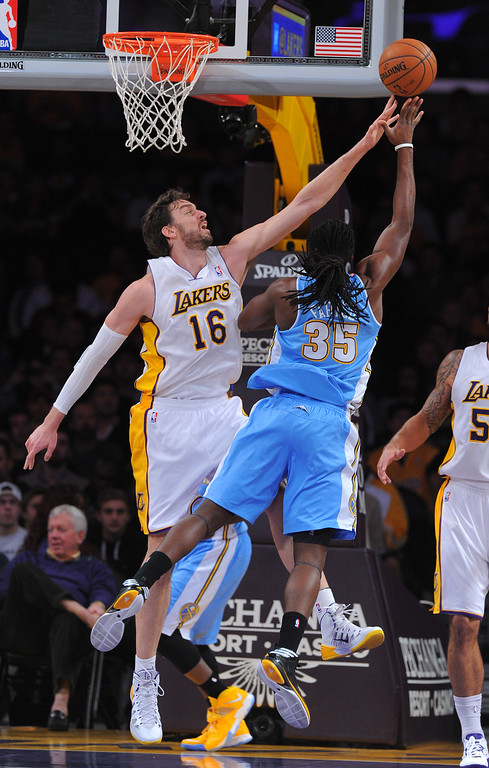 . Lakers\' Pao Gasol blocks a shot by Nuggets Kenneth Faried at the Staple Center in Los Angeles, CA on Sunday, January 5, 2014. 1st half.  (Photo by Scott Varley, Daily Breeze)