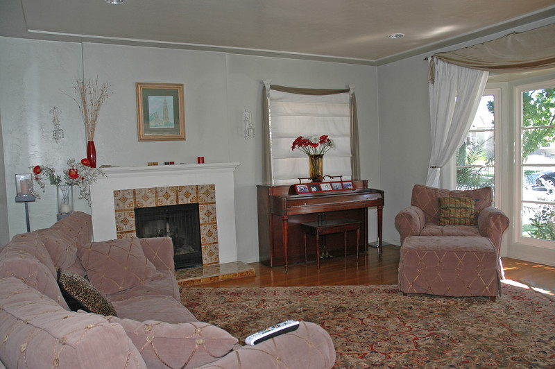 The living room has a fireplace with a gas log set and a cove ceiling.