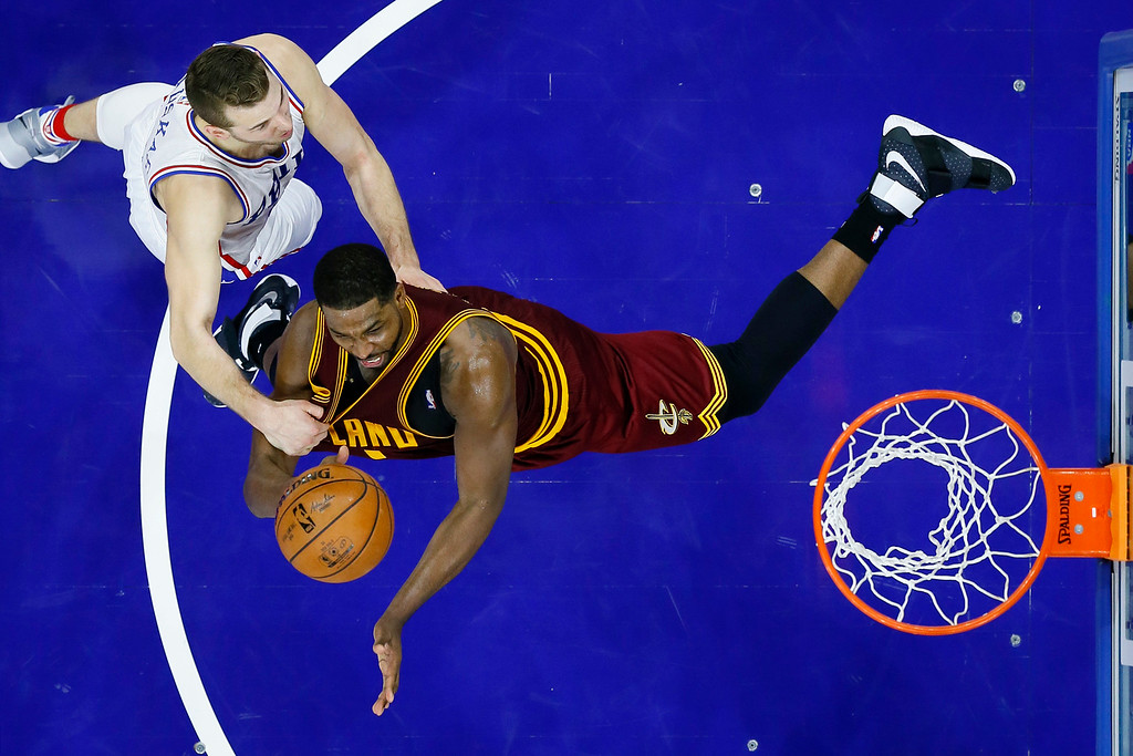 . Philadelphia 76ers\' Nik Stauskas, left, fouls Cleveland Cavaliers\' Tristan Thompson during the second half of an NBA basketball game, Sunday, Nov. 27, 2016, in Philadelphia. (AP Photo/Matt Slocum)