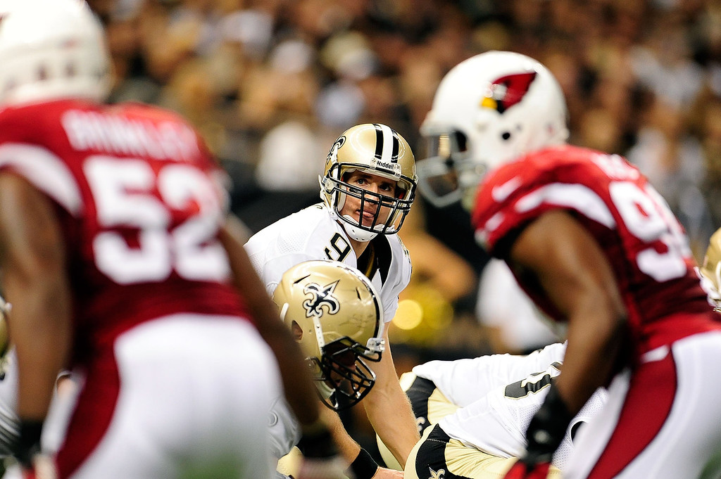 . Drew Brees #9 of the New Orleans Saints calls a play at the line during a game against the Arizona Cardinals at the Mercedes-Benz Superdome on September 22, 2013 in New Orleans, Louisiana.  The Saints defeated the Cardinals 31-7.  (Photo by Stacy Revere/Getty Images)
