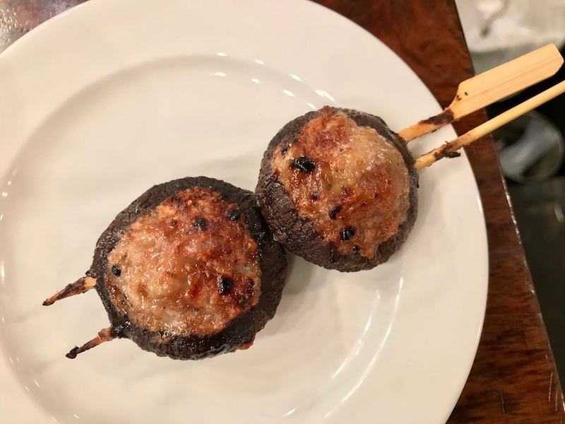 Meat-stuffed shiitake mushrooms on a skewer. Tasty!