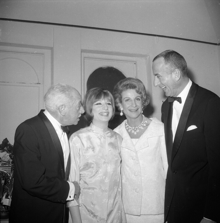 ". Barbra Streisand, who portrays Fanny Brice in the new musical ""Funny Girl\"", met with members of Fanny Brice\'s family backstage after the show\'s premiere March 26, 1964 in New York.  They are, left to right, Lew Brice, Fanny\'s brother; Streisand; Mrs. Ray Stark, Fanny Brice\'s daughter Fran, and the comedienne\'s son William Brice.  William Brice is a professor of art at the Universiry of California at Los Angeles.  This photo was taken in Miss Streisand\'s dressing room at the Winter Garden Theater in New York.  (AP Photo)"