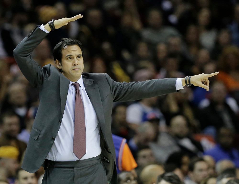 . Miami Heat head coach Erik Spoelstra signals his players in the first half of an NBA basketball game against the Cleveland Cavaliers, Friday, Dec. 9, 2016, in Cleveland. (AP Photo/Tony Dejak)