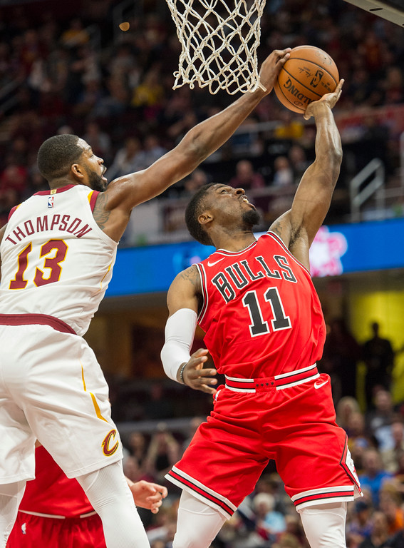 . Cleveland Cavaliers\' Tristan Thompson (13) blocks a shot by Chicago Bulls\' David Nwaba (11) during the first half of an NBA preseason basketball game in Cleveland, Tuesday, Oct. 10, 2017. (AP Photo/Phil Long)
