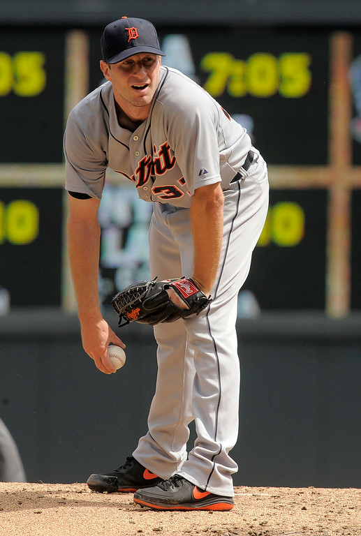. Detroit Tigers starting pitcher Max Scherzer looks in for the sign during the fifth inning of a baseball game in against the Minnesota Twins in Minneapolis, Sunday, Aug. 24, 2014. Scherzer got his 15 win as the Tigers beat the Twins 13-4. (AP Photo/Tom Olmscheid)