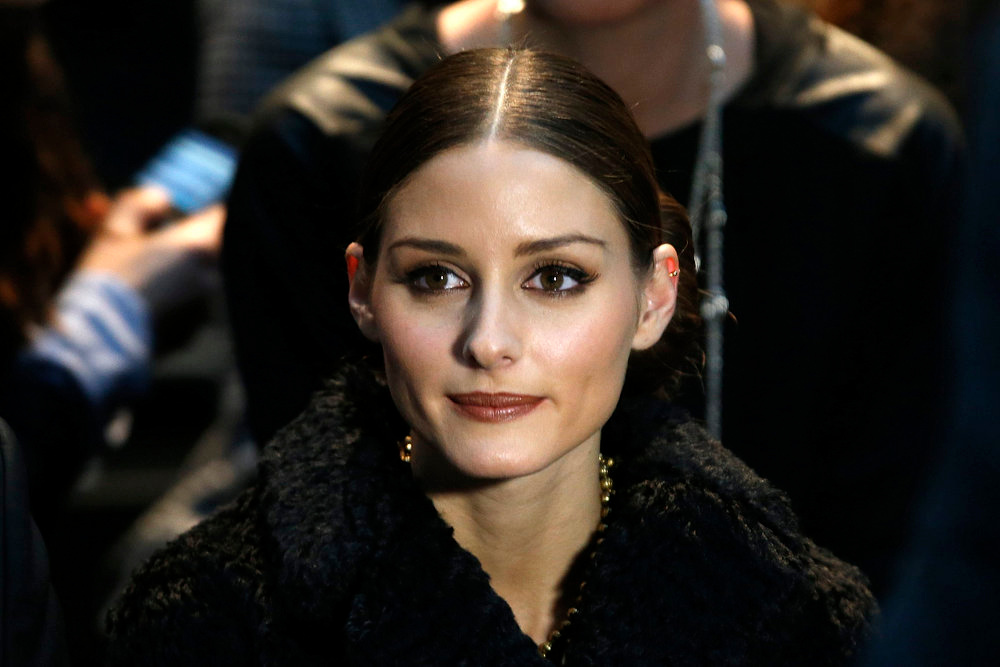 Description of . American socialite, actress and model Olivia Palermo attends Italian designer Marco Zanini\'s Fall-Winter 2013/2014 women\'s ready-to-wear show for French fashion house Rochas during Paris fashion week February 27, 2013.    REUTERS/Charles Platiau
