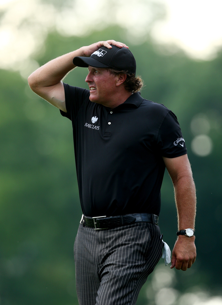 . Phil Mickelson of the United States reacts on the tenth green during the final round of the 96th PGA Championship at Valhalla Golf Club on August 10, 2014 in Louisville, Kentucky.  (Photo by Jeff Gross/Getty Images)