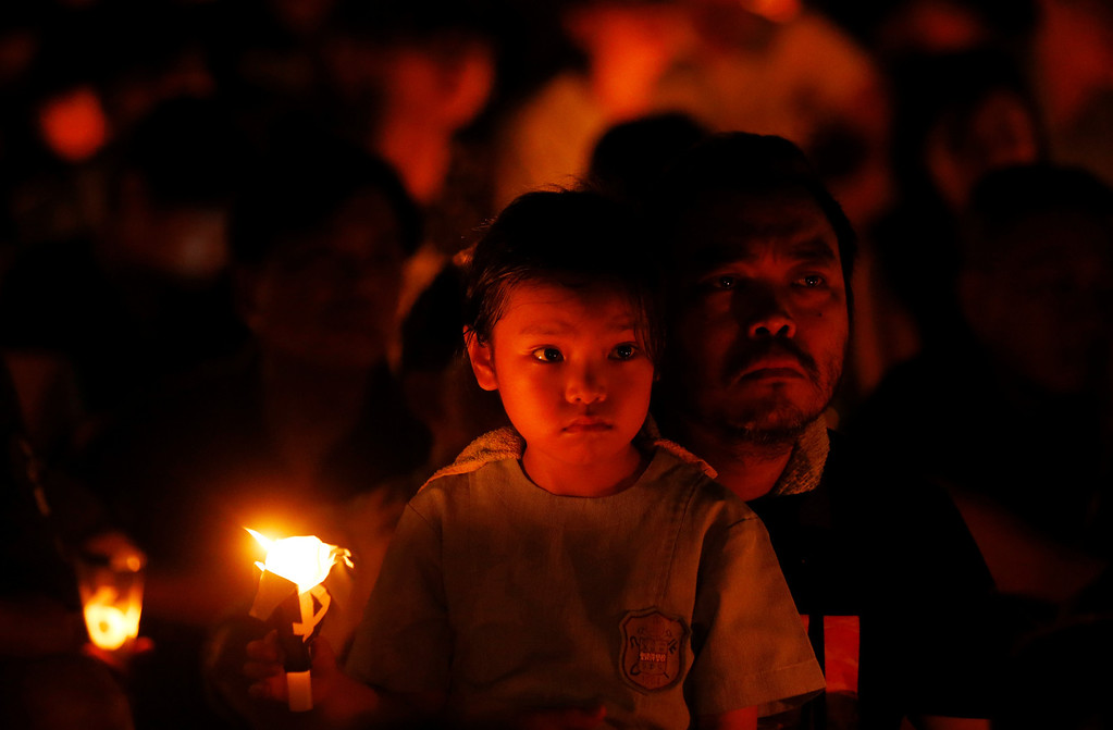 . Tens of thousands of people attend a candlelight vigil at Victoria Park in Hong Kong Wednesday, June 4, 2014, to mark the 25th anniversary of the June 4th Chinese military crackdown on the pro-democracy movement in Beijing. (AP Photo/Kin Cheung)