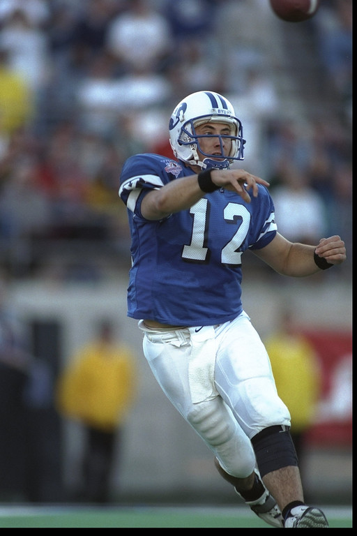 . 7 Dec 1996:  Quarterback Steve Sarkisian of the Brigham Young Cougars passes the ball during a game against the Wyoming Cowboys at Sam Boyd Stadium in Las Vegas, Nevada.  BYU won the game, 28-25.  Mandatory Credit: Todd Warshaw/Allsport