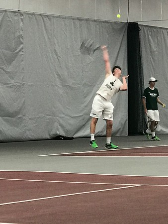 Dusty playing Tennis