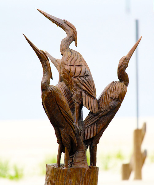 Carved trees memorialize the devastation of Hurricane Katrina.