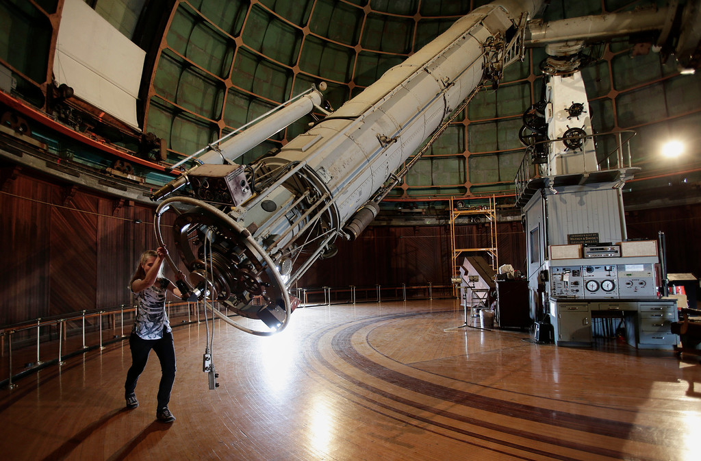 ". Astronomer Elinor Gates manually moves the 36"" Refractor telescope at Lick Observatory east of San Jose, Calif. on Wednesday, May 8, 2013. The observatory will be celebrating its 125th anniversary. The telescope is so delicate that there are only about a dozen people in the world that are certified to move it.  (Gary Reyes/ Bay Area News Group)"