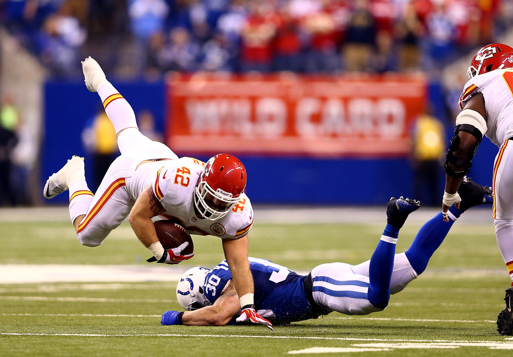 . INDIANAPOLIS, IN - JANUARY 04: Fullback Anthony Sherman #42 of the Kansas City Chiefs is tackled by strong safety LaRon Landry #30 of the Indianapolis Colts during a Wild Card Playoff game at Lucas Oil Stadium on January 4, 2014 in Indianapolis, Indiana.  (Photo by Andy Lyons/Getty Images)