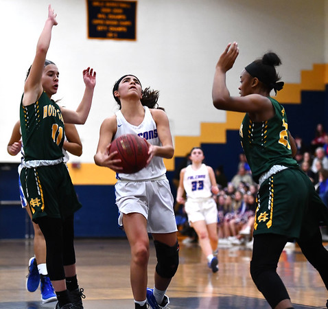 2/26/2020 Mike Orazzi | StaffrSt. Paul Catholic High School's Janessa Gonzalez r(11) and Holy Cross' Mya Zaccagnini (11) and Cayla Howard (23) during Wednesday night's CCC girls basketball tournament at Kennedy High School in Waterbury.