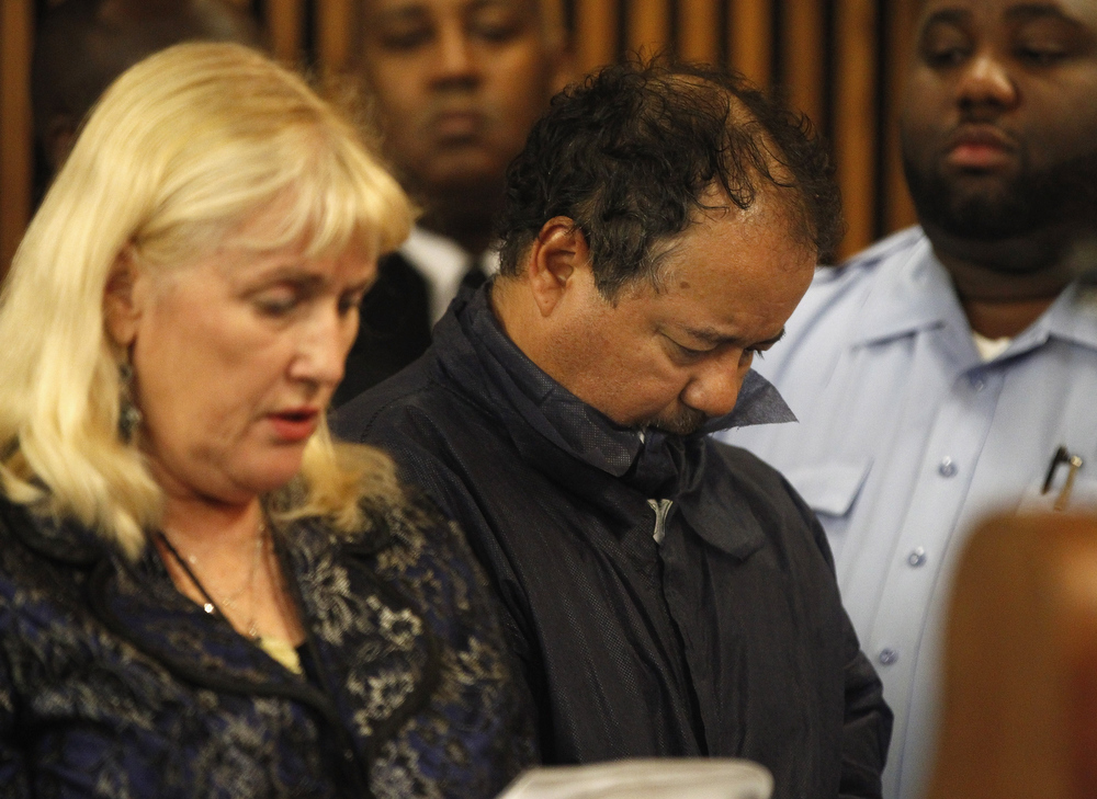 . Ariel Castro (R) stands with his public defender, Kathleen DeMetz, during his arraignment on kidnapping and rape charges on May 9, 2013 in Cleveland, Ohio.  Castro is accused of abducting three girls, Michelle Knight, 32, Amanda Berry, 27 and Gina DeJesus, believed to be about 23 and holding them for about 10-years. (Photo by Matt Sullivan/Getty Images)