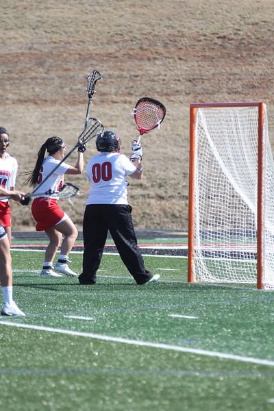 00, Reagan Hall defends the goal.