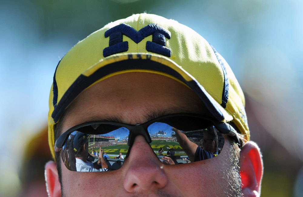 Description of . A fan of the Michigan Wolverines watches  play against the South Carolina Gamecocks in the Outback Bowl January 1, 2013 at Raymond James Stadium in Tampa, Florida.  (Photo by Al Messerschmidt/Getty Images)