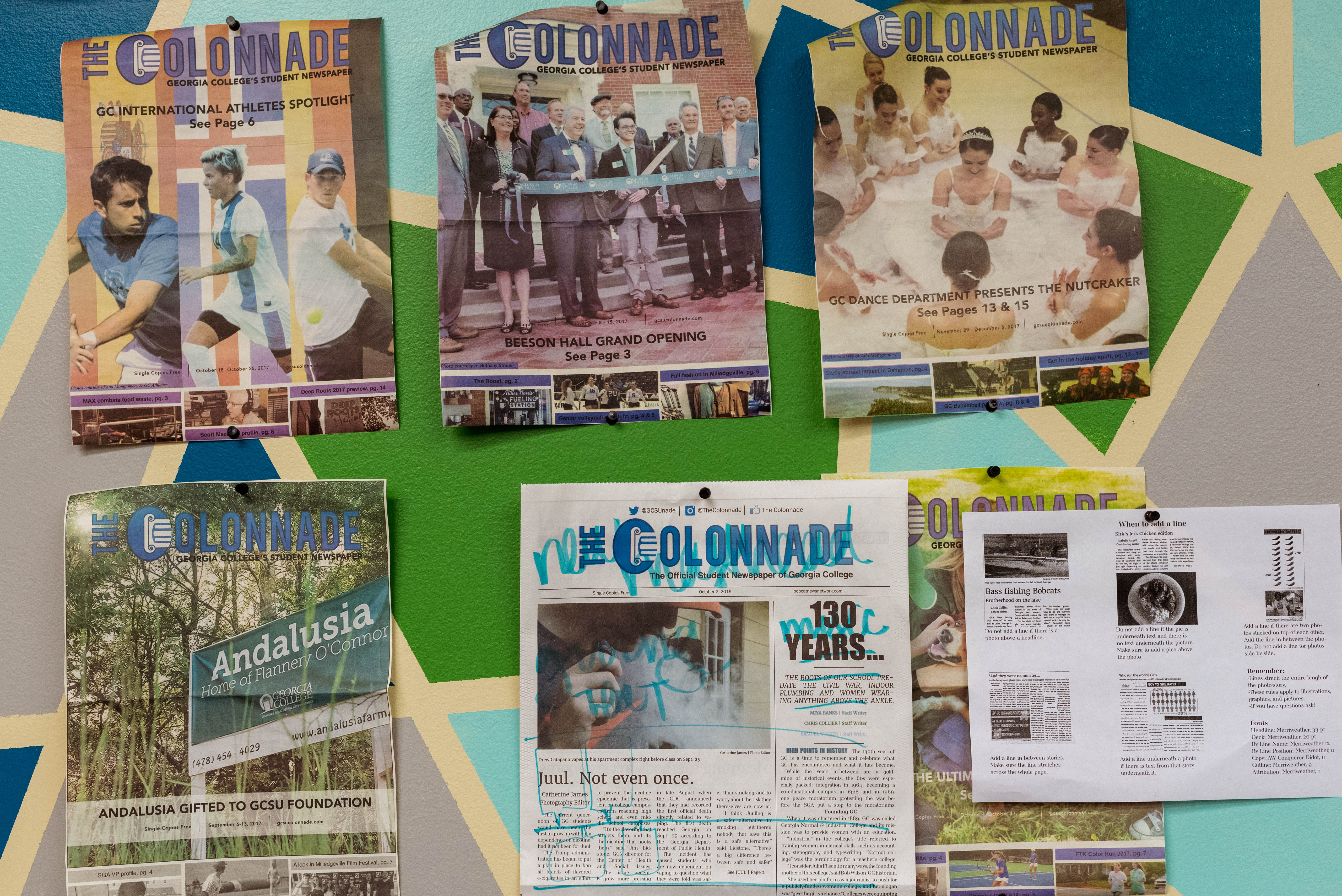 Different issues of The Colonnade hang at the editor's desk