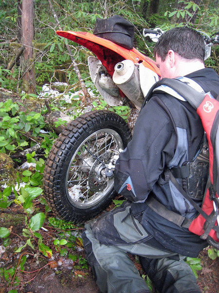 """Dan pumping up the magically """"healed"""" tire.  Is Tahuya like the island on """"Lost""""?  Do tires self-repair out there?"""