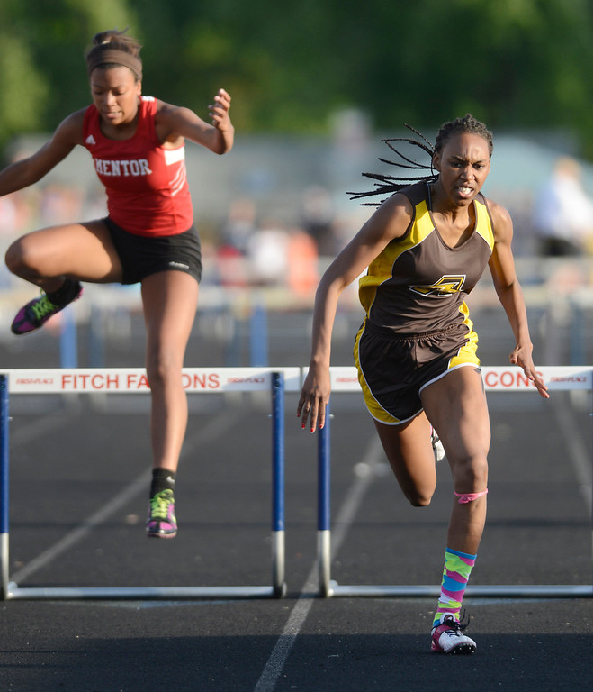 . Maribeth Joeright/MJoeright@News-Herald.com<p> Brush\'s Asya Reynolds qualified for state in the girls 300 meter hurdles during the Division I regional final track meet, May 30, 2014. Also shown is Mentor\'s Aysha Muhammad.