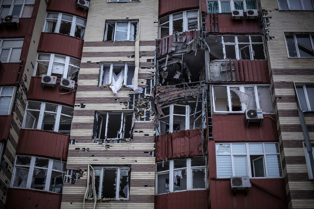 . A building hit by the Ukrainian Army Artillery is seen in Voroshilovsky area, center of Donetsk, Ukraine. Sunday, Jan. 18, 2015. The separatist stronghold, Donetsk, was shaken by intense outgoing and incoming artillery fire as a bitter battle raged for control over the city\'s airport. Streets in the city, which was home to 1 million people before unrest erupted in spring, were completely deserted and the windows of apartments in the center rattled from incessant rocket and mortar fire. (AP Photo / Manu Brabo)