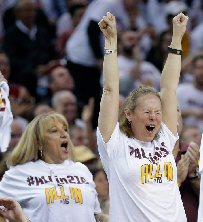 . Cleveland Cavaliers fans celebrate in the first half in Game 2 of a first-round NBA basketball playoff series between the Detroit Pistons and the Cleveland Cavaliers, Wednesday, April 20, 2016, in Cleveland. The Cavaliers won 107-90. (AP Photo/Tony Dejak)