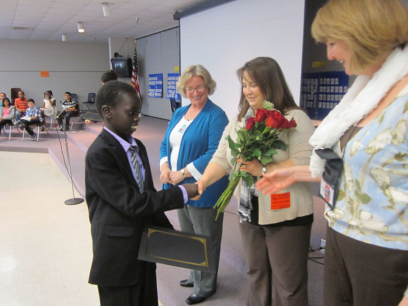 5428_TRACKS_Scholar_Kwat_receives_congratualtion_from_Believer_Ms._StorypKohl_and_Principal_Bowhay_1200x900.JPG