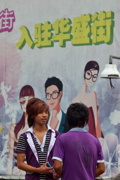 Shanghai, China - September 3, 2009: Young teenage Chinesse boys hanging out in downtown Shanghai.  (Photo by: Christopher Herwig)