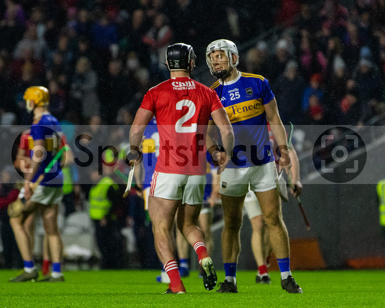 Tipperary's Niall O'Meara shakes hands with Cork's Colm Spillane