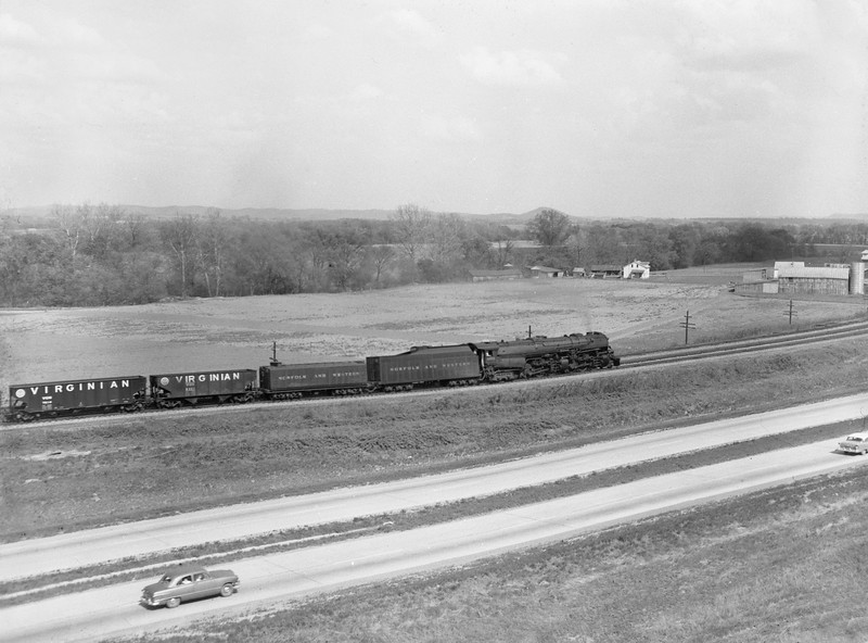 2018.15.N79.6213E--ed wilkommen 3x4 neg--N&W--steam locomotive 2-6-6-4 A 1202 on coal freight train scene--location unknown--no date