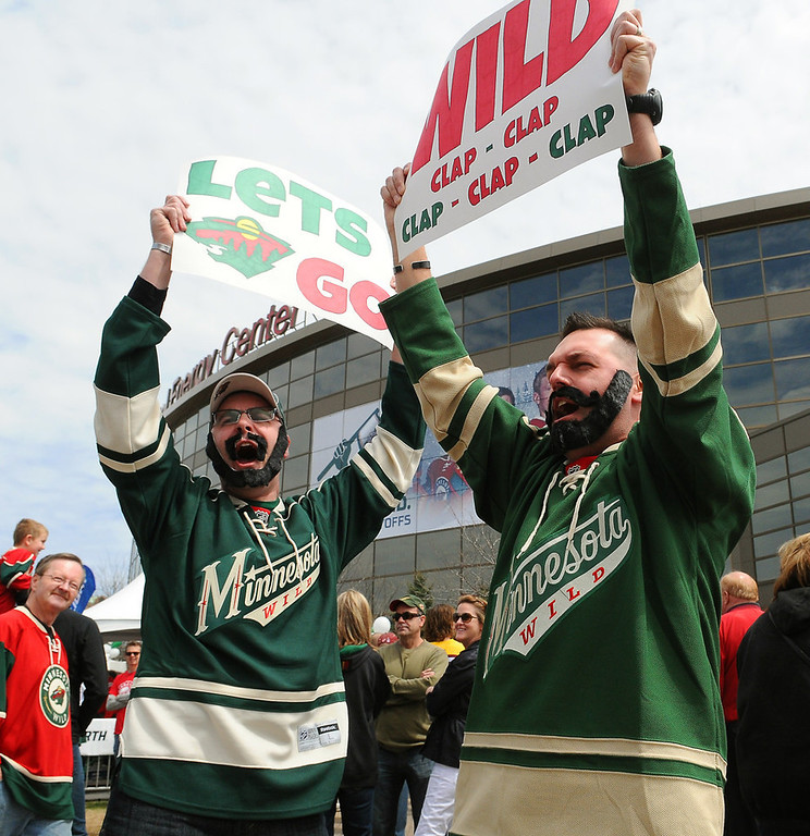 """. Bill Butler, left and Mike Lubovich, both of St. Paul, sport \""""playoff beards\"""" as they rally the crowd outside the Xcel Energy Center before the start of Game 3 against the Blackhawks. Butler said he started the beard Sunday morning.  (Pioneer Press: John Autey)"""