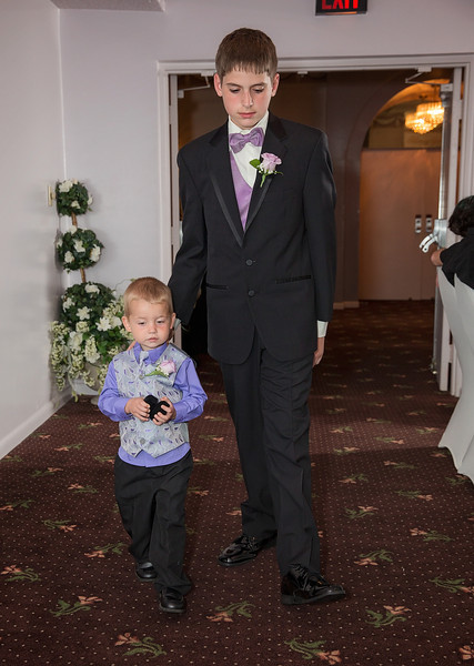 Son and Ring Bearer walking down aisle.jpg