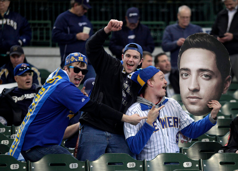 . Fans hold up a giant photo of Milwaukee Brewers Ryan Braun before the start of opening day of baseball season as the Milwaukee Brewers take on the Colorado Rockies in a MLB baseball game in Milwaukee, Wisconsin April 1, 2013. REUTERS/Darren Hauck