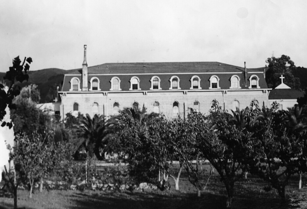 . Circa 1925 - Domincian convent hidden behind olive and palm groves behind the Mission church. (Oakland Tribune Staff Archives)