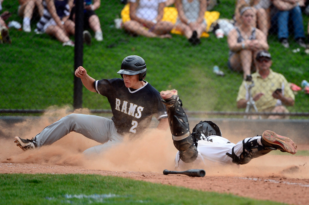 . LAKEWOOD, CO - MAY 23: Green Mountain\'s Chaser Upson is safe at home as he gets past catcher Isiah Mayberry. The Durango Demons take on the Green Mountain Rams in the 4A Baseball State Semi-Final Championships. (Kathryn Scott Osler, The Denver Post)
