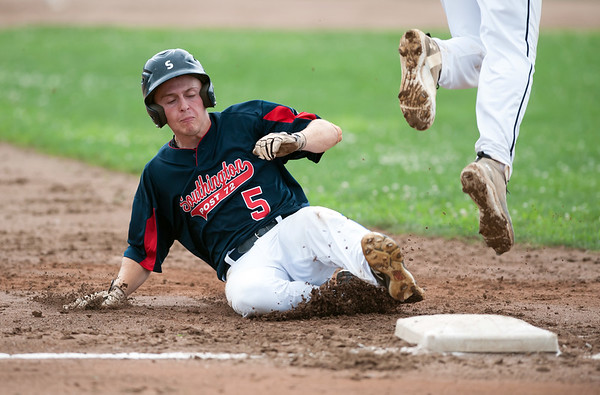 07/25/18 Wesley Bunnell | Staff Southington Post 72 vs Trumbull in American Legion Baseball on Wednesday afternoon. Daniel Topper (5) slides safely into third as the throw from the Trumbull catcher sails into left field.