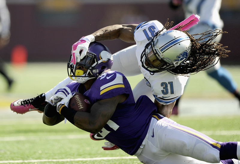 . Rashean Mathis #31 of the Detroit Lions tackles Jerick McKinnon #31 of the Minnesota Vikings during the second quarter of the game on October 12, 2014 at TCF Bank Stadium in Minneapolis, Minnesota. (Photo by Hannah Foslien/Getty Images)
